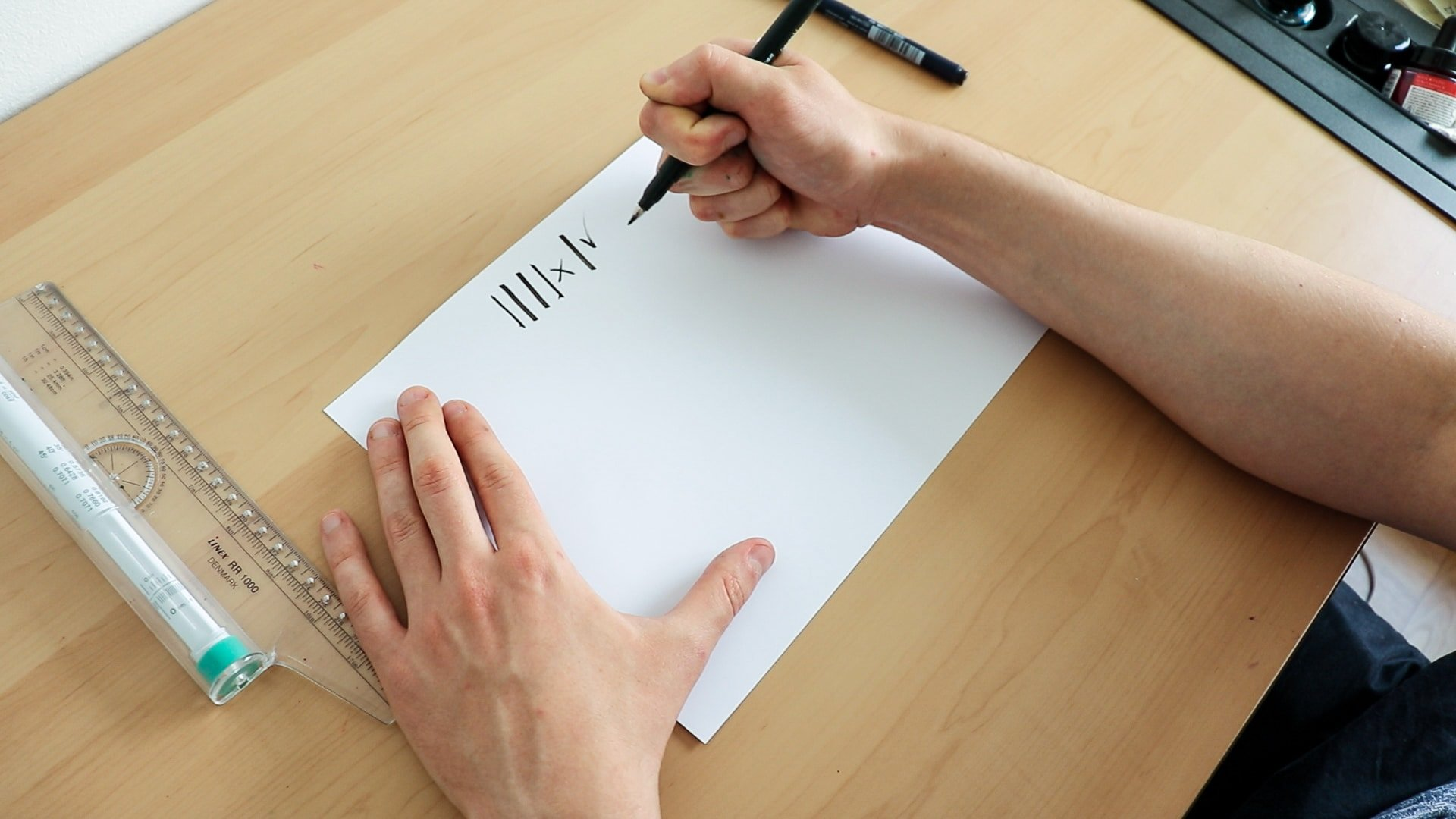 Holding the brush pen in a fist-like position